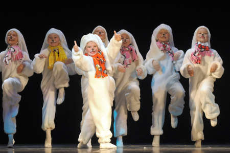 Children dancing in bunny costumes Editorial