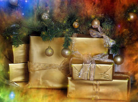 gifts in gold packaging under the Christmas tree photo