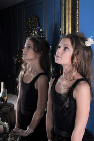 admires: Girl admires herself in the mirror