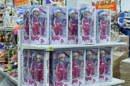 barbie: Shelves full of children toys in a Italian toys shop in Petersburg. Russia.