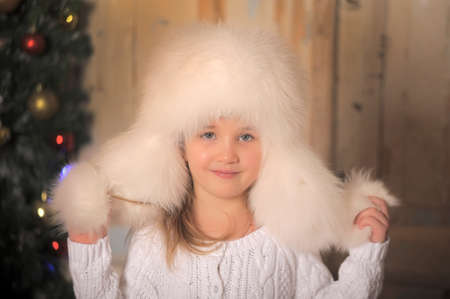 topknot: Young girl with wearing fur hat. Stock Photo