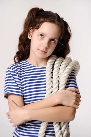 Girl in a striped T-shirt and breeches with rope. photo