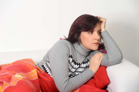 couching: Woman in depression sitting on the couch Stock Photo