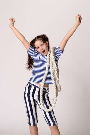 breeches: Girl in a striped T-shirt and breeches with rope. Stock Photo