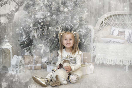 girl in Christmas at the Christmas tree photo