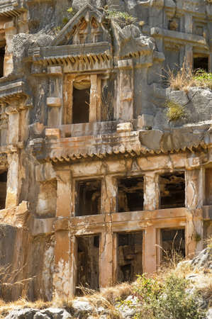 past civilization: Tombs carved into the rocks in the town of Demre. Stock Photo