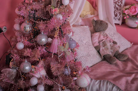 Interior children room in pink tones with Christmas tree. photo