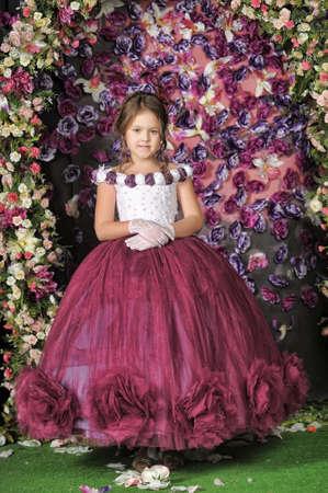 Vintage portrait of little girl in purple dress. photo