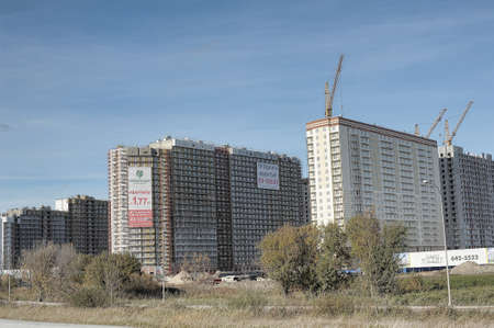 neighbours: Multi-storey building under construction, new construction area for the beltway, St. Petersburg, Russia.