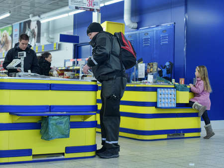 shoppingcarts: Customers at the cash register in the supermarket, Lappentanta, Finland. Editorial