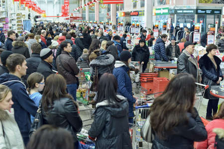supermarket checkout: Auchan store rush hour