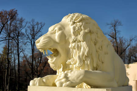 pushkin: Sculpture of a white lion on a background of blue sky, park in Pushkin, Russia
