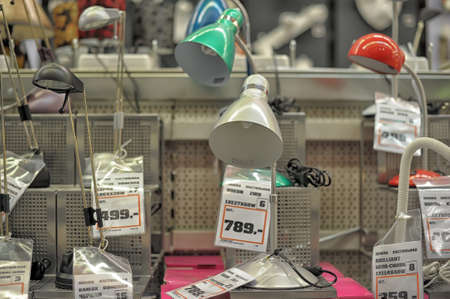 displayed: Home and office lighting products are displayed on the shelves in a hardware store. Editorial