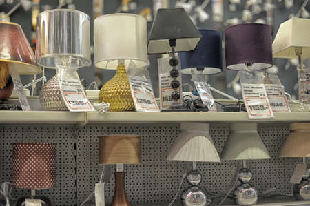 office lighting: Home and office lighting products are displayed on the shelves in a hardware store. Editorial