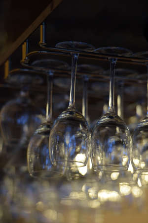 aberrations: Hanging wineglasses, selective focus, lot of color reflections and chromatic aberrations left intentionally.