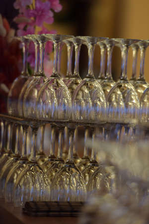 chromatic: Hanging wineglasses, selective focus, lot of color reflections and chromatic aberrations left intentionally.