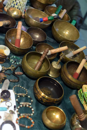 singing bowls: Tibetan singing bowls with batons for sale.