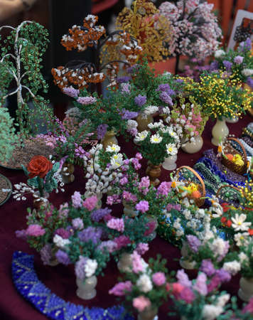 self made: Flowers and trees from beads on the folk art exhibition.
