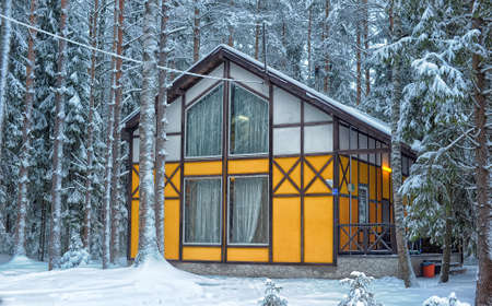 white winter: Yellow house with white in the winter forest.