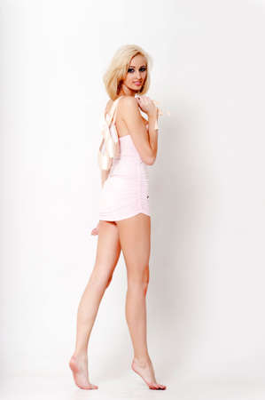 Sexy blonde in a short dress with pointes. Stock Photo