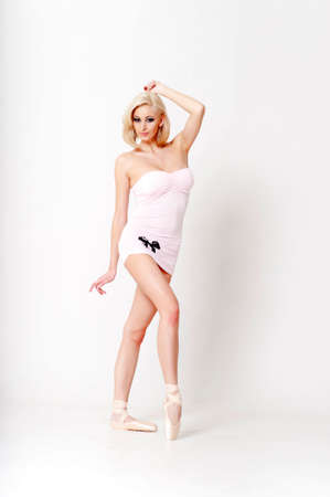 pointes: Sexy blonde in a short dress with pointes. Stock Photo