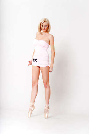 tight fitting: Sexy blonde in a short dress with pointes. Stock Photo