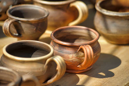 loamy: Clay pots and jugs for sale. Stock Photo