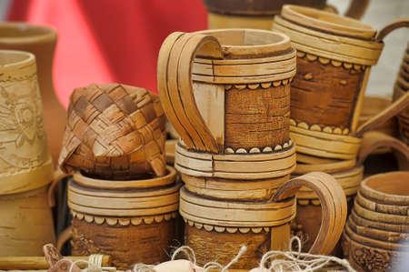 bast: Bast mugs on wooden table.