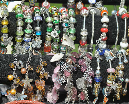 charms: Bracelets with charms for sale. Stock Photo