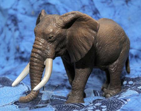 toy elephant: Plastic toy elephant on a blue background.