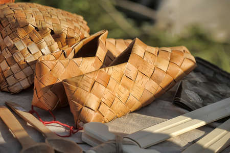 braided: Products of national crafts, braided sandals. Stock Photo