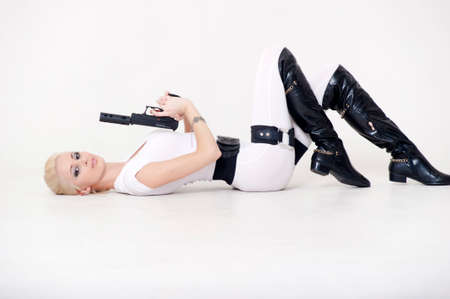 aiming: Sexy blonde with a gun in hand. Stock Photo