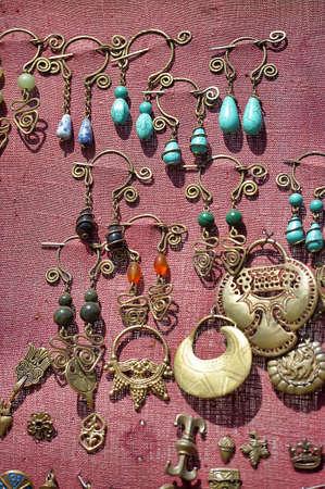 brassy: Medieval copper amulets for sale.