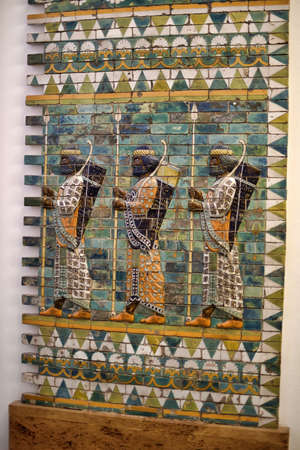 babylonian: Babylonian Archers. These men with bows and spears are depicted at the Ishtar Gate, one of the gates to ancient Babylon. The base relief was reconstructed at the Pergamon Museum, in Berlin, Germany. Stock Photo