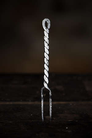 medieval blacksmith: Medieval old wrought iron fork. Stock Photo