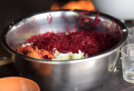 ifestyle: Grated vegetables in an iron bowl for soup.