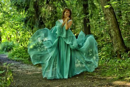 Woman Dancing In Fashion Dress, Fabric Cloth Waving On Wind. Reklamní fotografie