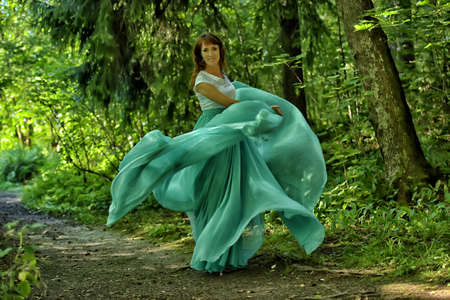 Beauty woman with dress flying