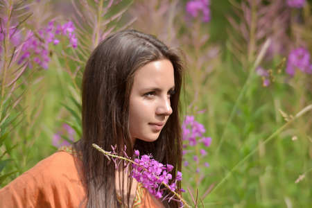 amongst: Viking girl amongst a field with willow-tea. Stock Photo