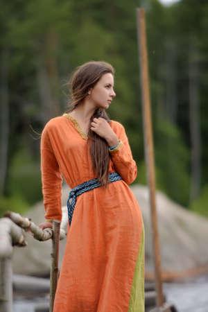 ethnic dress: girl in ethnic dress orange Stock Photo