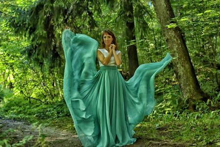 cotton fabric: Woman Dancing In Fashion Dress, Fabric Cloth Waving On Wind.