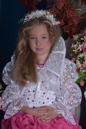 toyshop: Young princess in a pink and white dress