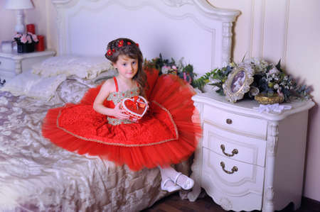 Small dark-haired girl in a red dress