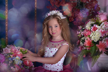 toyshop: Young princess in a pink and white dress among the flowers Stock Photo