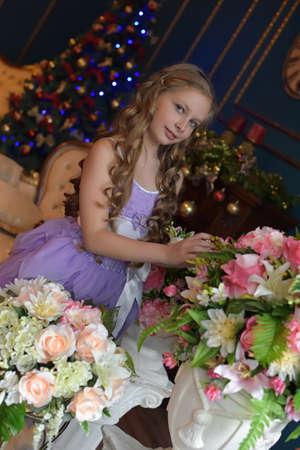 Portrait of cute little girl in princess dress.