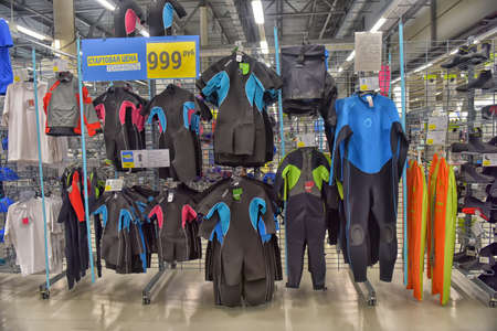 Wetsuits in a sports shop, Decathlon, St. Petersburg, Russia.