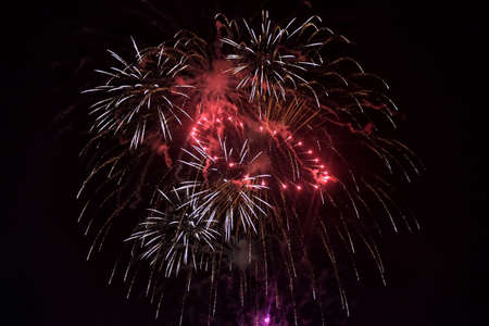 dispersed: Fireworks flash in the dark sky to celebrate festivity.