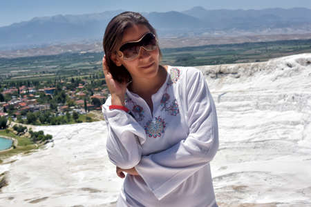 carbonates: Woman in white on a background of calcium Pamukkale travertine.