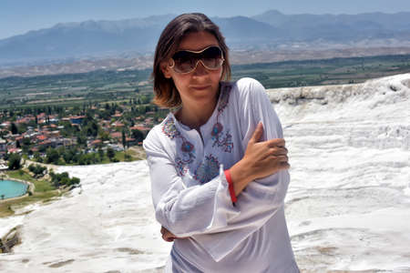calcium: Woman in white on a background of calcium Pamukkale travertine.
