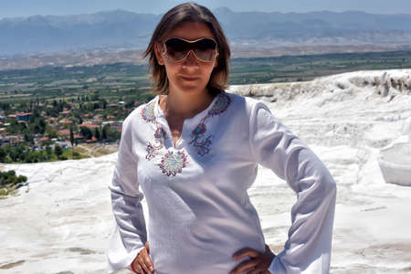 travertine: Woman in white on a background of calcium Pamukkale travertine.